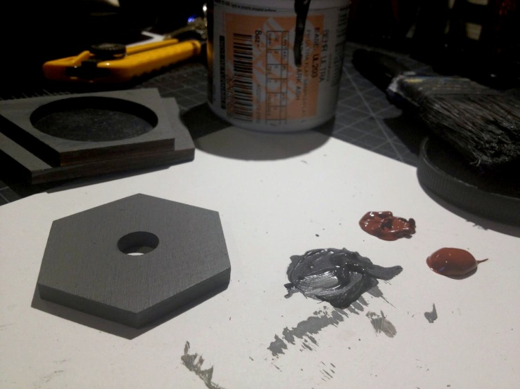 Image of wooden pieces painted grey.