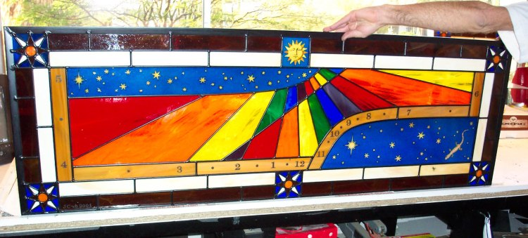 Stained-glass window sundial made by John Carmichael.
