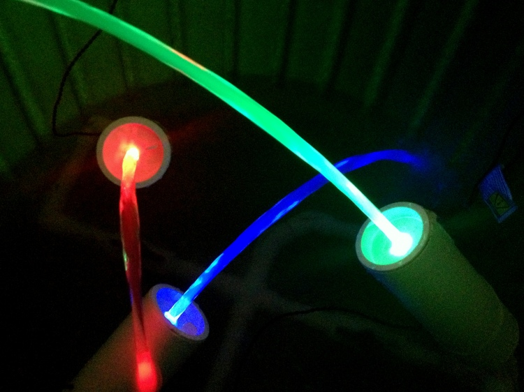 Image of three laminar flow nozzles lit with in-line LEDs.