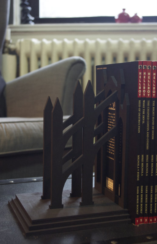 Side view of the black flying buttress bookends.
